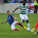 On the slide: Linfield defender Chris Casement tackles Moussa Dembele at Windsor Park