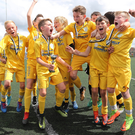 Big impact: The victorious Dungannon United team celebrate their under-11 success