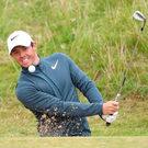 Digging deep: Rory McIlroy plays out of a bunker at Royal Birkdale en route to a two-under-par 68