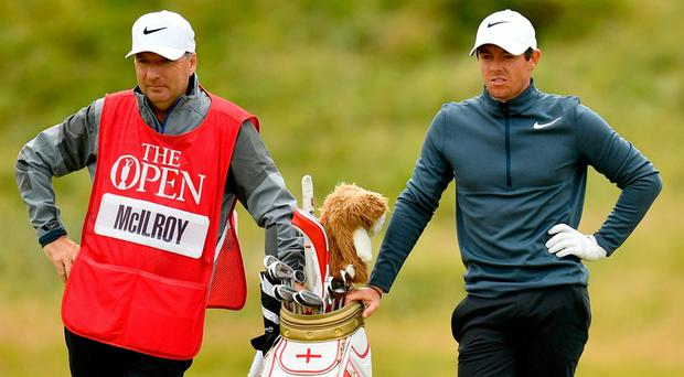 Rory McIlroy of Northern Ireland and caddie JP Fitzgerald look on from the 17th hole during the second round of the 146th Open Championship at Royal Birkdale on July 21, 2017 in Southport, England. (Photo by Dan Mullan/Getty Images)