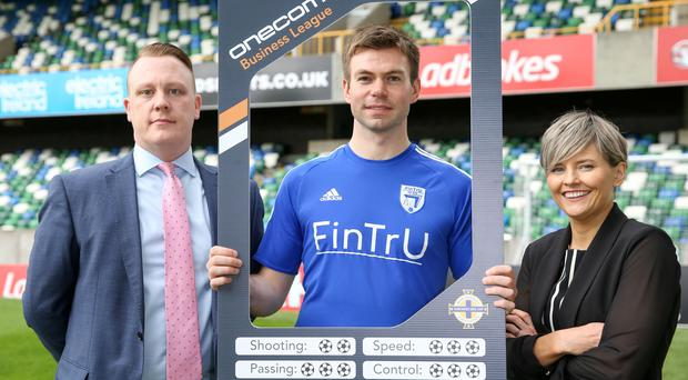 From left, Paul Lawther, head of Onecom in Northern Ireland, FinTrU team captain Mark McKeown and Irish FA sales and marketing director Oonagh O'Reilly