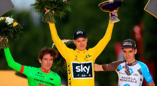 Number four: Tour winner Team Sky's Chris Froome (centre) celebrates victory on the podium next to second placed Cannondale's Rigoberto Uran (left) and third placed AG2R La Mondiale's Romain Bardet (right) after stage 21 of the Tour de France in Paris. Photo: Adam Davy/PA