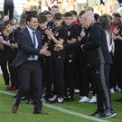Up and running: David Healy is greeted by his coach at Linfield, Alfie Wylie, who is also the Northern Ireland women's Under-19 boss, during the opening ceremony for the SuperCupNI last night. Photo: Arthur Allison.