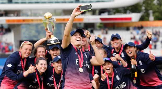 Picture this: England players pose after winning the ICC Women's World Cup cricket final. Photo: Getty Images