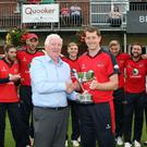 Still the best: Tommy Anderson, managaing director of sponsors Lagan Valley Steels presents Waringstown captain Greg Thompson with the NCU T20 Cup for the second successive year. Photo: Freddie Parkinson/Presseye
