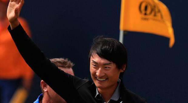 Brilliant Li: Li Haotong acknowledges gallery applause for his feat. Photo: Peter Byrne/PA