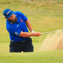 Bunker shot: Andrew Johnston plays out of the sand at Birkdale