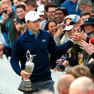 Top man: Jordan Spieth acknowledges the fans.