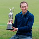 Major coup: Open champion Jordan Spieth shows off the famous Claret Jug
