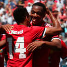 Goal: United scorer Lingard takes salute from Martial. Photo: Getty Images