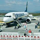 Passengers leave the Ryanair flight which arrived at City of Derry Airport on thursday afternoon. Many of the passengers where stranded after the volcanic eruption in Iceland forced the closure of UK airspace. Picture Martin McKeown. Inpresspics.com. 22.4.10