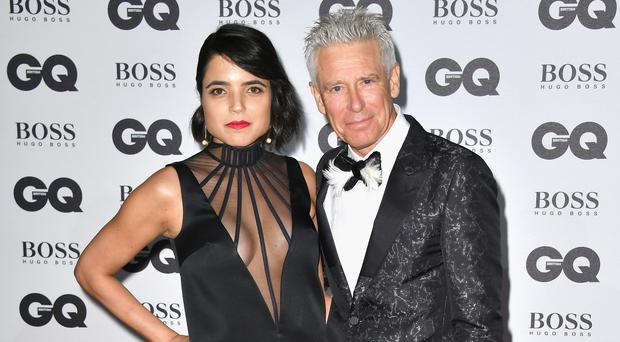 Mariana De Carvalho and Adam Clayton (Photo by Gareth Cattermole/Getty Images)