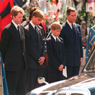 Saying goodbye: The princes at Diana's funeral with their uncle and dad