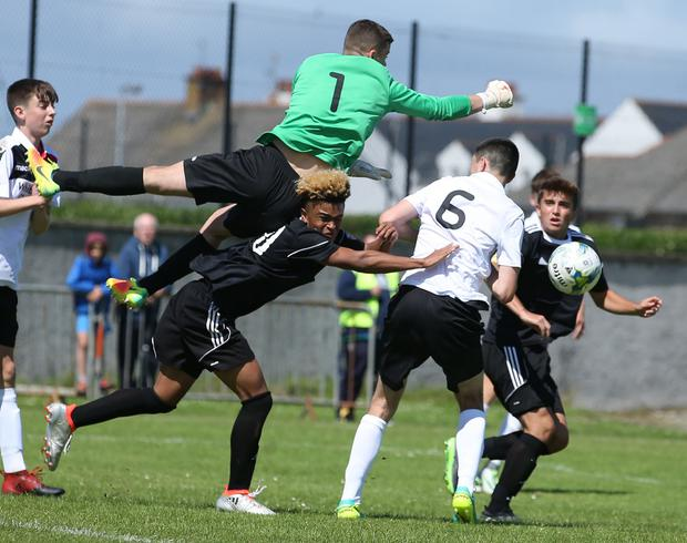 PressEye-Northern Ireland- 26th July 2017-Picture by Brian Little/ PressEye SuperCupNI Junior Section Cherry Orchard goal keeper Jimmy Corcoran and GPS Bayern Hesselmeyer Donovan during Wednesday's SuperCup NI Junior Section match at Castlerock . Picture by Brian Little/PressEye