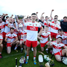 Cup kings: Derry captain Ciaran Steele and his team-mates celebrate winning the Ulster Under-21 decider last night. Photo: Matt Mackey/Presseye