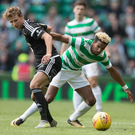 On the ball: Celtic's Scott Sinclair gets the better of Vegar Eggen Hedenstad of Rosenborg