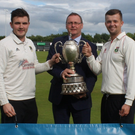 Big stage: Cup final captains RIcky-Lee Dougherty of Donemana (left) and Lee Ritchie of Ballyspallen get their hands on the Bank of Ireland Senior Cup with Ian Stone from the sponsors