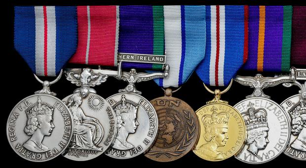 The auctioned medals included a Special Ops Northern Ireland Queen's Gallantry Medal (far left)