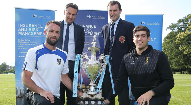 Up for the Cup: rival captains Nigel Jones of CIYMS (front left) and Nikolai Smith of Instonians with the NCU Arthur J Gallagher Senior Challenge Cup they will compete for in the final in Comber today. Standing are Shane Matthews, regional managing director of Arthur J Gallagher, and Peter McMorran, President of the NCU