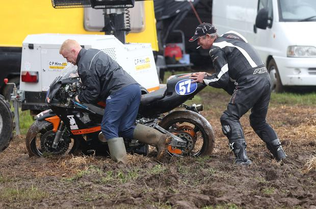 PACEMAKER, BELFAST, 29/7/2017: Competitors struggled with the muddy conditions in the paddock at Armoy road races today after heavy rain during the week turned the fields into a quagmire. PICTURE BY STEPHEN DAVISON