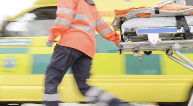 A man in his 70s was resuscitated with a defibrillator following a heart attack and airlifted to hospital.