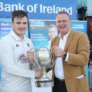 Champion display: Ian Stone, Bank of Ireland, presenting the Bank of Ireland North West Senior Cup to Ricky-Lee Dougherty, captain, Donemana CC. Photo: Lorcan Doherty/Presseye