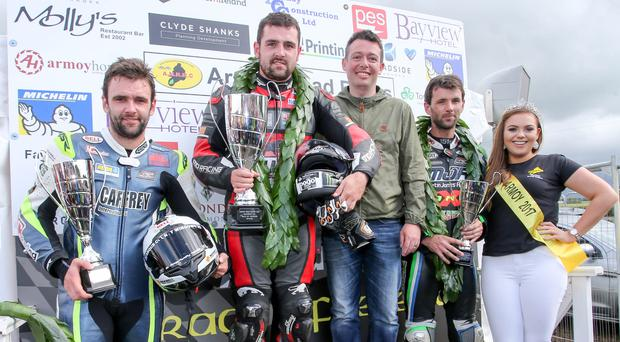 Top step: Armoy Race of Legends winner Michael Dunlop, 2nd placed William Dunlop and 3rd placed Michael Sweeney with Miss Armoy, Emma McGarrity, and Mark Lamont of sponsors Roadside Kia. Photo: Philip Magowan/Presseye
