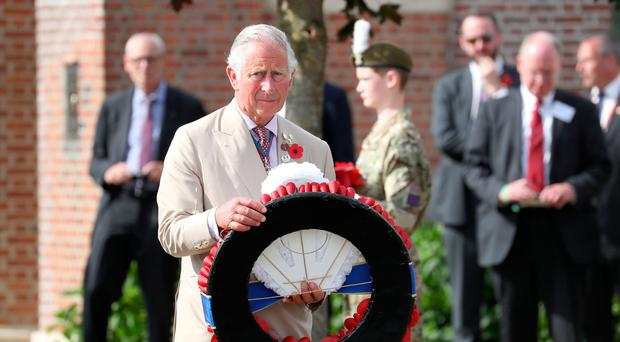 Prince of Wales lays a wreath during a visit to Artillery Wood Cemetery