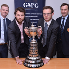Up for Cup: Andrew Hodgins of CSNI II (second left) and Michael Warke, captain of Instonians II, with the GMcG NCU Junior Cup the teams will contest at Muckamore on Saturday. Also pictured are Nigel Moore (left) of GMcG Chartered Accountants and NCU President Peter McMorran. Photo: Rowland White/PressEye