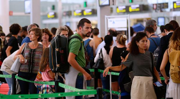 Passengers wait at security control at Barcelona airport in Spain yesterday. (AP Photo/Manu Fernandez)