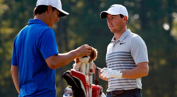 Rory McIlroy of Northern Ireland speaks to his new caddie Harry Diamond during a preview day of the World Golf Championships - Bridgestone Invitational at Firestone Country Club South Course on August 2, 2017 in Akron, Ohio. (Photo by Sam Greenwood/Getty Images)