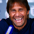 All smiles: Antonio Conte faces the media yesterday