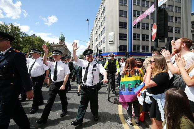 Members of the PSNI and the Garda join thousands of people as they take part in the annual Belfast Pride event in Belfast city centre celebrating Northern Ireland's LGBT community. Photo by Kelvin Boyes / Press Eye.