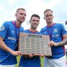 Linfield scorers Andrew Mitchell, Paul Smyth and Aaron Burns celebrate their side's Action Mental Health Charity Shield victory.