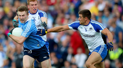 Too good: Monaghan's Kieran Duffy and Drew Wylie struggle to get to grips with Dublin's Jack McCaffrey on Saturday evening