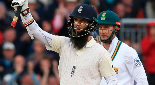 Dominant: Moeen Ali salutes the crowd at Old Trafford