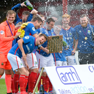Winners: Linfield players celebrate with the Charity Shield