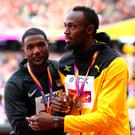 Together: Gatlin and Bolt at medal ceremony last night