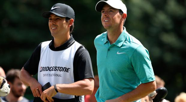 Rory McIlroy of Northern Ireland and caddie Harry Diamond look on from the seventh tee during the final round of the World Golf Championships - Bridgestone Invitational at Firestone Country Club South Course on August 6, 2017 in Akron, Ohio. (Photo by Gregory Shamus/Getty Images)