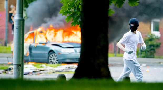 Republican youths riot over seizure of bonfire material in Belfast