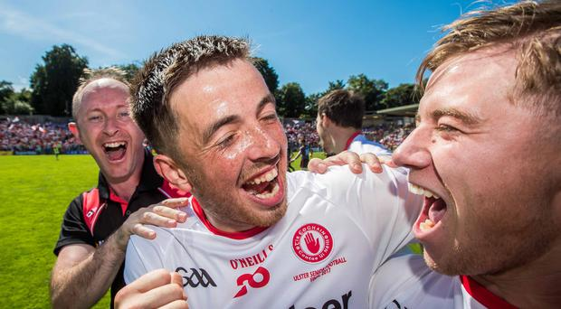 Bring it on: Mark Bradley (right) says the Red Hands will savour the 'crazy' build-up to their All-Ireland semi-final with Dublin