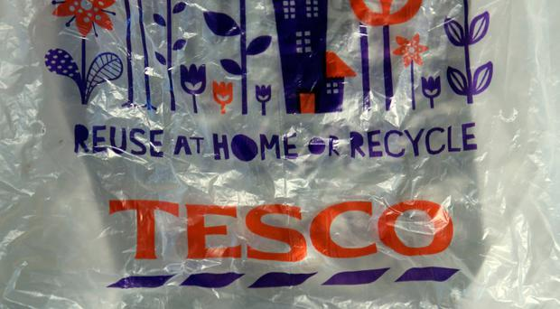 File photo of a Tesco plastic bag, as the supermarket is to stop selling single-use plastic bags in its stores, replacing them with