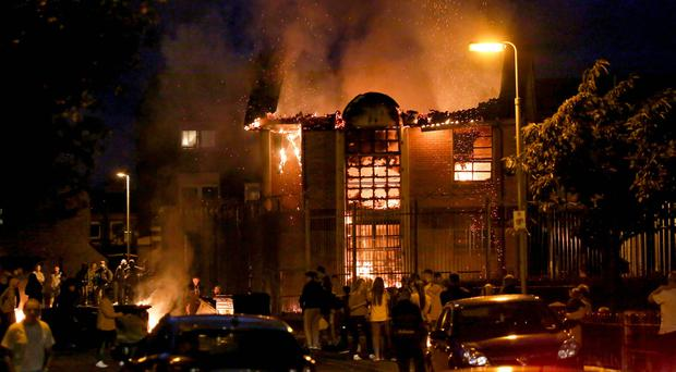 Trouble erupts in the Divis area of Belfast as the Credit Union is set alight after bonfire material was removed on August 7th 2017 (Photo by Kevin Scott / Belfast Telegraph)