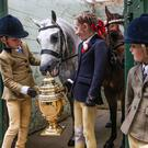 Jack, Mia and Georgia de Bromhead (aged 8, 8 and 6) watch Apples the pony at the launch of the Dublin Horse Show
