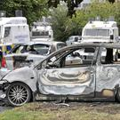 The damage caused to cars by Monday night's arson attacks and rioting