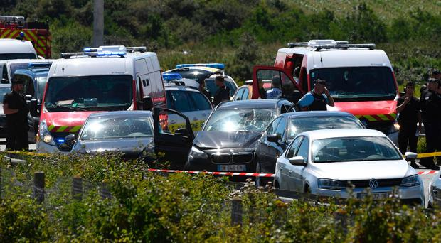 French police and emergency workers intervene on the site after the police arrested a suspect on the A16 motorway, near Marquise, northern France, on August 9, 2017. Police gave chase to the vehicle on a motorway north of Paris.
