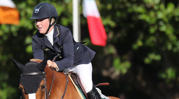 Up and over: Jenny Rankin, of Fintona, jumps to Dublin Horse Show victory on Beech Hill Lucia. Photo: Laurence Dunne