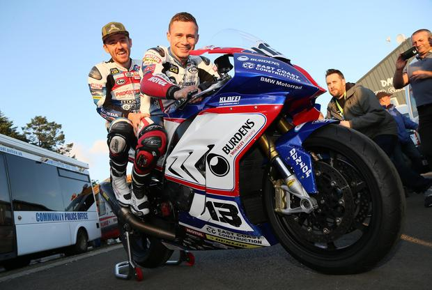 PACEMAKER, BELFAST, 9/8/2017: Road racer Lee Johnston and boxer Carl Frampton before they set of on a lap of the Ulster Grand Prix circuit at Dundrod on a motorbike this evening ahead of their charity chat show in aid of Marie Currie at the event. PICTURE BY STEPHEN DAVISON