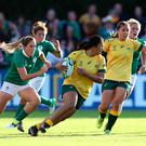 DUBLIN, IRELAND - AUGUST 09: Liz Patu of Australia runs with the ball during the Women's Rugby World Cup 2017 match between Ireland and Australia on August 9, 2017 in Dublin, Ireland. (Photo by David Rogers/Getty Images)
