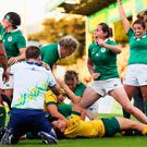 Ireland players celebrate as Sophie Spence scores her side's third try Australia last night. Photo: Brian Lawless/PA
